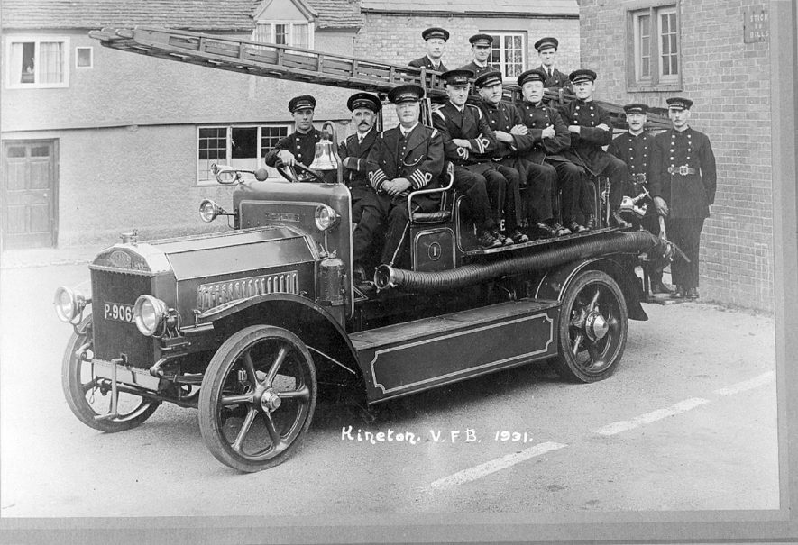 Kineton Fire engine with firemen.  Copied from original negative 1955. |  IMAGE LOCATION: (Warwickshire County Record Office)