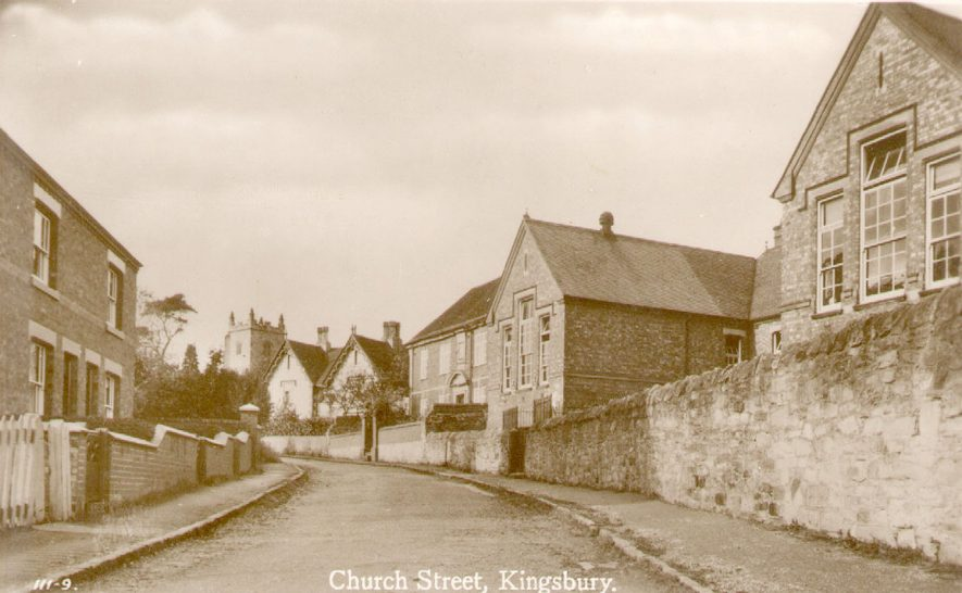 Church Street (now Lane), Kingsbury, with the school on the right and the church tower in the background.  1920s    IMAGE LOCATION: (Warwickshire County Record Office)