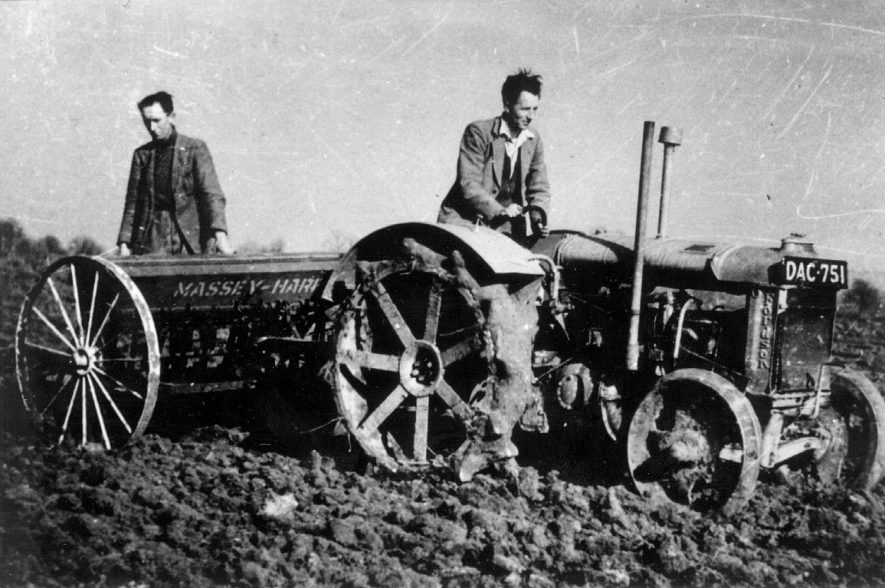 Duke of Buccleuch Estate, Dunchurch. War effort: sowing grain on ploughed out grassland. Tractor and two labourers.  1942 |  IMAGE LOCATION: (Warwickshire County Record Office)