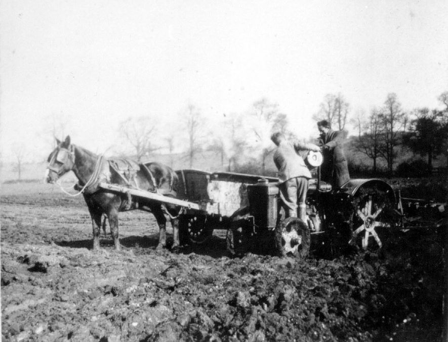 Duke of Buccleugh Estate, Dunchurch. Refuelling tractor. Part of war effort. Horse and cart. Two labourers.  1942 |  IMAGE LOCATION: (Warwickshire County Record Office)