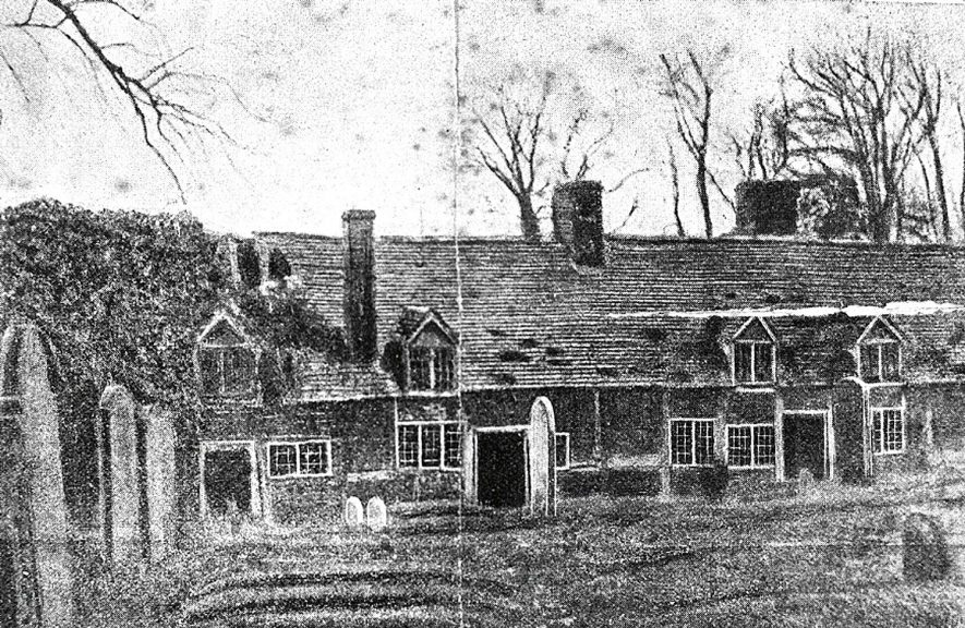A row of almshouses in Lapworth.  1900s |  IMAGE LOCATION: (Warwickshire County Record Office)