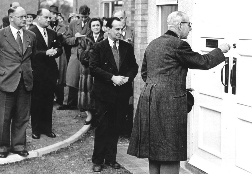 Lord Willoughby de Broke performs the official opening of Napton Victory Club.  In the picture left to right are Mr Chas. Watson who compiled the original plan.  Mr Cyril Watson who built the club.  Mrs C. Watson (background) and Sir Charles Shuckburgh.  1956 |  IMAGE LOCATION: (Warwickshire County Record Office) PEOPLE IN PHOTO: Willoughby, Lord de Broke, Willoughby, de Broke as a surname, Watson, Mrs C, Watson, Cyril, Watson, Chas, Watson as a surname, Shuckburgh, Sir Charles, Shuckburgh as a surname
