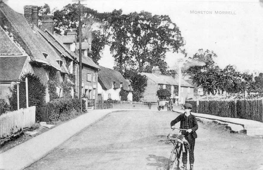 Village street and boy with bicycle, Moreton Morrell.  1910s |  IMAGE LOCATION: (Warwickshire County Record Office)