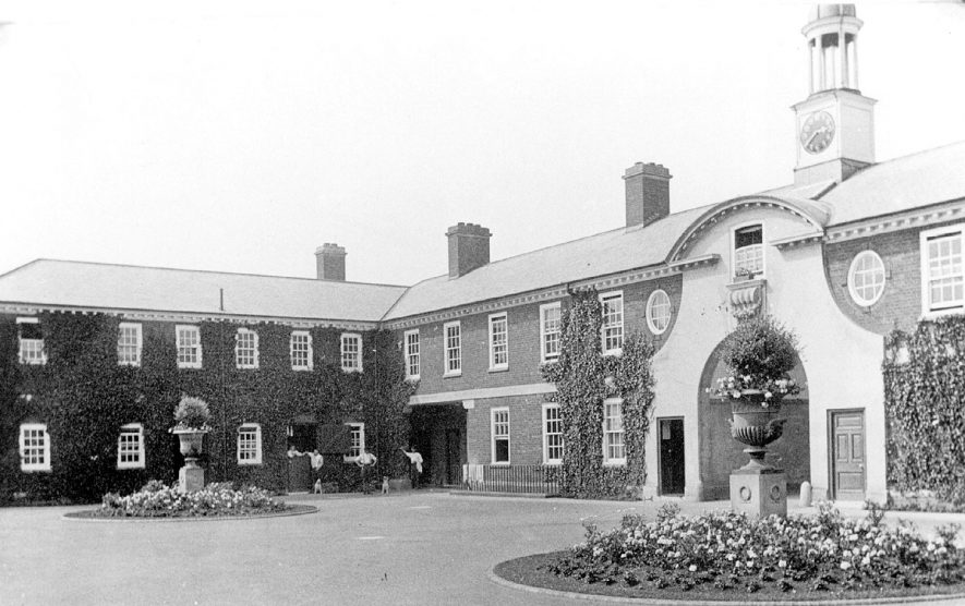 The stableyard at Moreton Hall, showing the gateway and part of the building, Moreton Morrell.  1909    IMAGE LOCATION: (Warwickshire County Record Office)