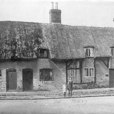 Monks Kirby.  Cottages on village green