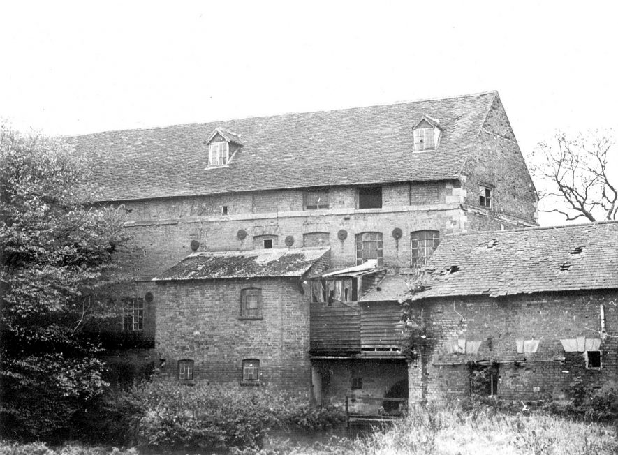 Rear view of Rock mills, Milverton. On this photograph can be seen the sluice gate and the opening for the water wheel (bottom centre).  1971    IMAGE LOCATION: (Warwickshire County Record Office)