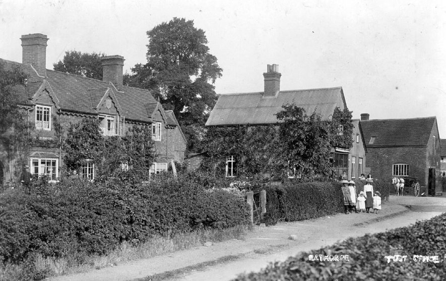 Post office and cottages in Eathorpe. People standing outside Post Office.  1900s |  IMAGE LOCATION: (Warwickshire County Record Office)