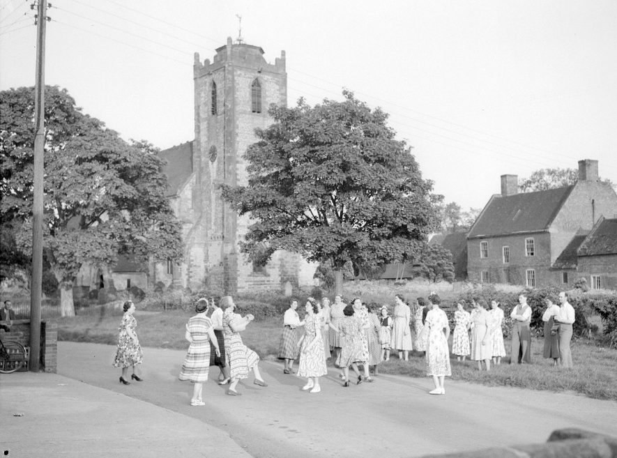 Country dancers in front of the church at Long Itchington.  June 2nd 1951    IMAGE LOCATION: (Warwickshire County Record Office)