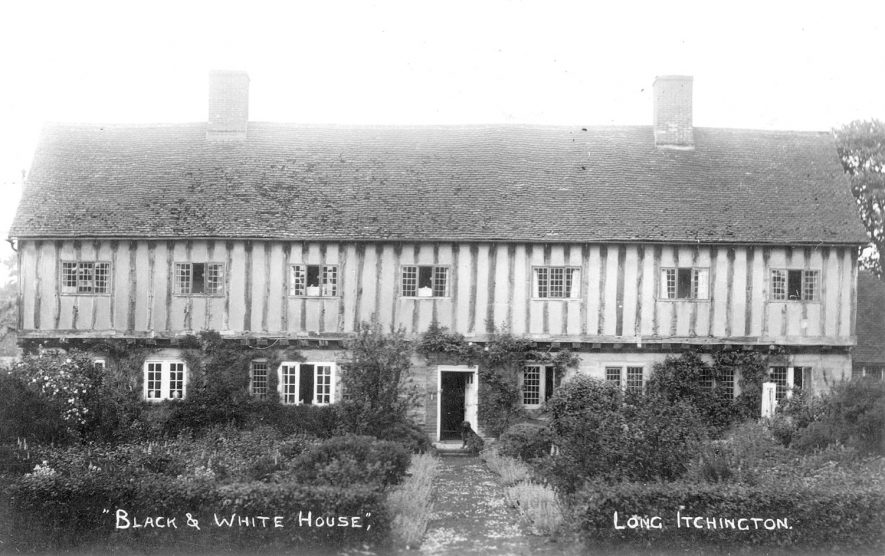 A large black and white timbered house in Long Itchington.  1920s |  IMAGE LOCATION: (Warwickshire County Record Office)
