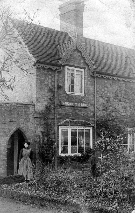 The Post Office at Eathorpe with lady standing in doorway.  1900s |  IMAGE LOCATION: (Warwickshire County Record Office)