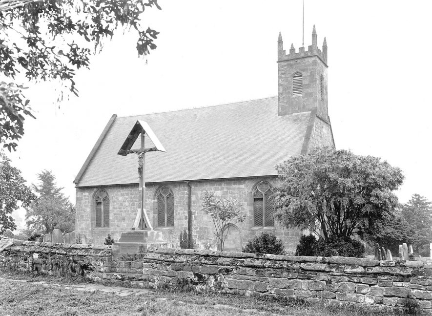 St Michael's Church, Maxstoke, with a crucifix in the churchyard.  1950s |  IMAGE LOCATION: (Warwickshire County Record Office)
