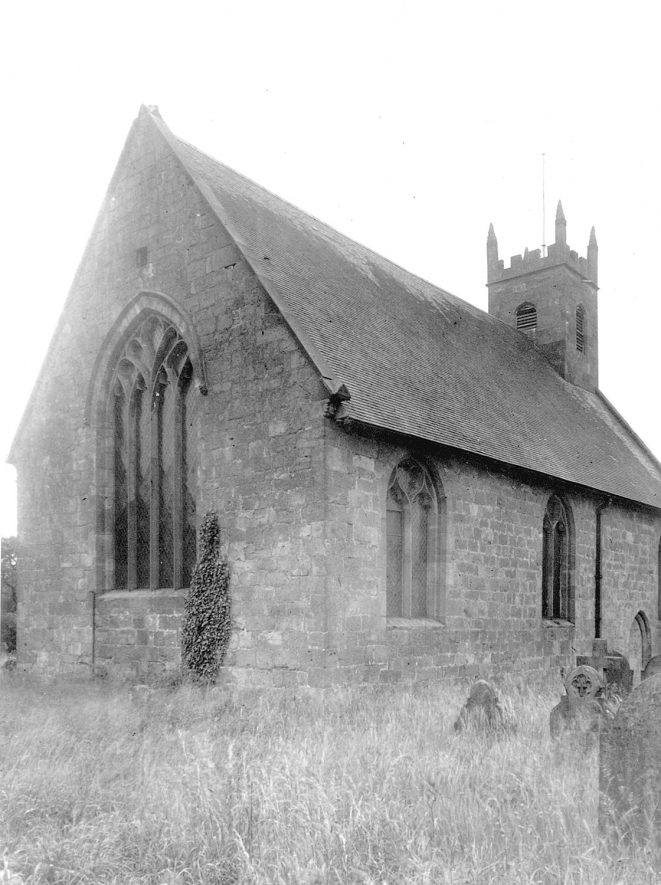 View of the exterior of the west end of St Michael's Church, Maxstoke.  1950s |  IMAGE LOCATION: (Warwickshire County Record Office)