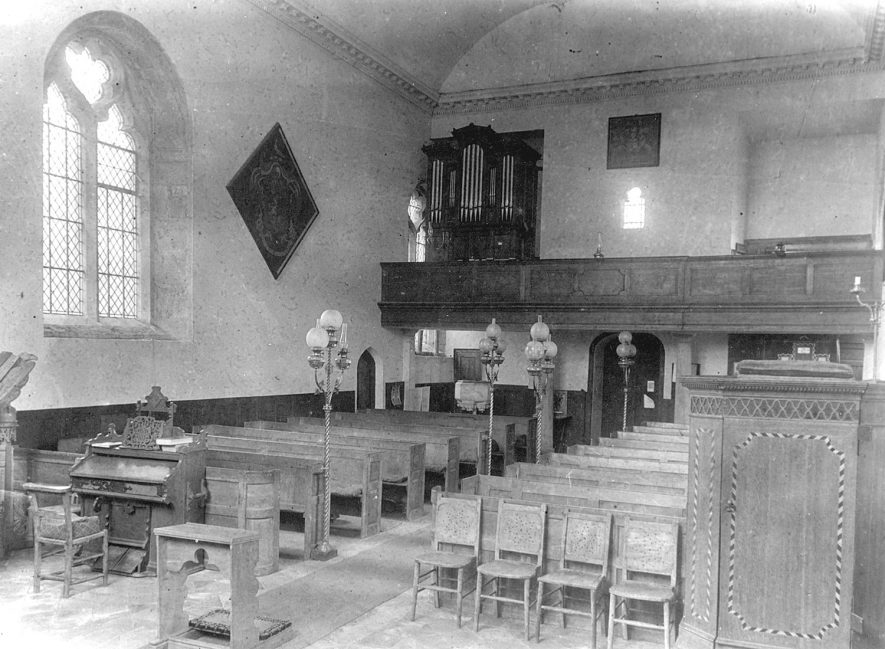 The interior, looking west, of St Michael's Church, Maxstoke.  1950s |  IMAGE LOCATION: (Warwickshire County Record Office)