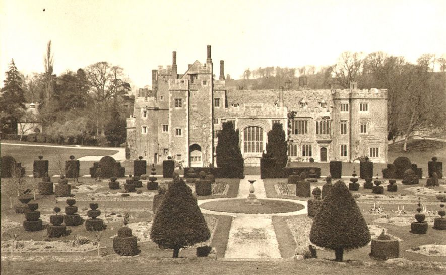 Compton Wynyates house and gardens, showing much of the topiary.  1930s |  IMAGE LOCATION: (Warwickshire County Record Office)