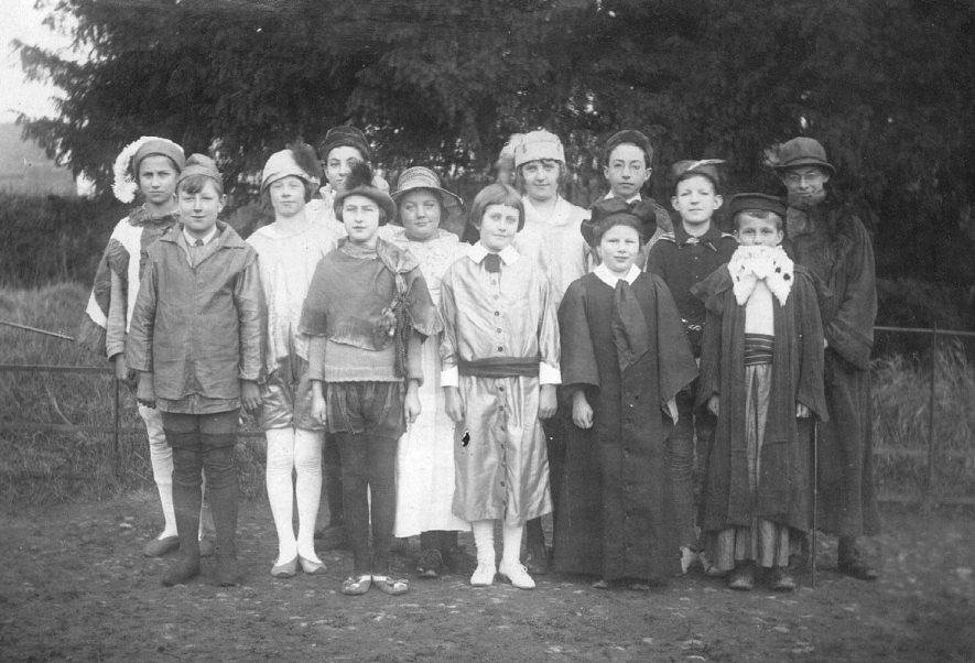 A group of children from Ladbroke School posing as part of a school play.  1925