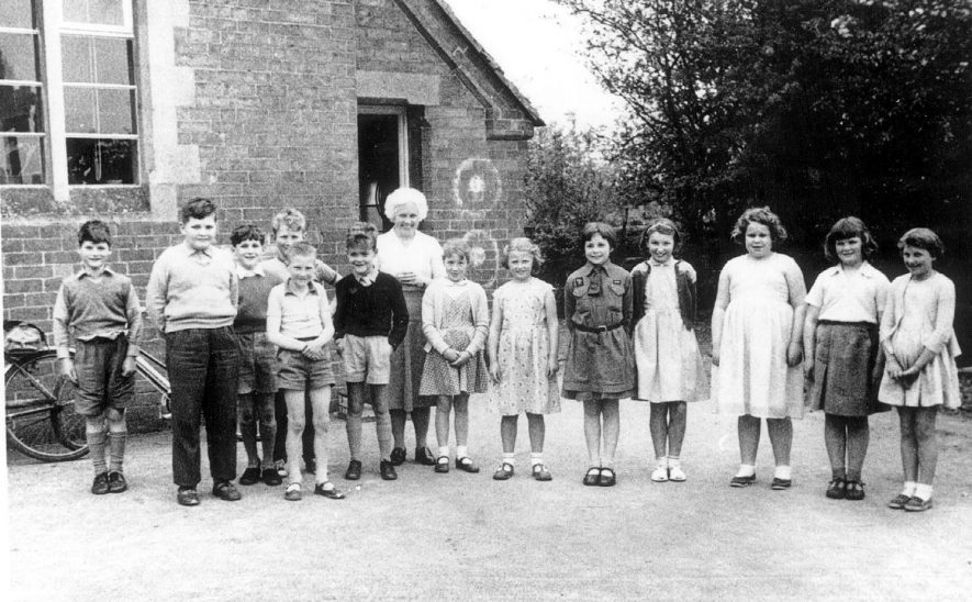 Group of schoolchildren with their teacher outside Cherington school.  1950s |  IMAGE LOCATION: (Warwickshire County Record Office)