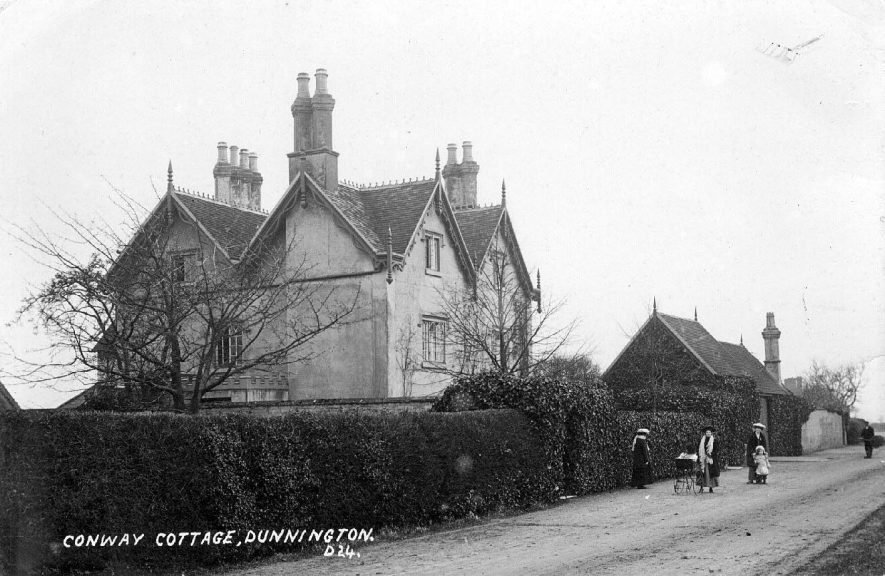 Conway Cottage, Dunnington.  Women with perambulator and children outside.  1900s |  IMAGE LOCATION: (Warwickshire County Record Office)