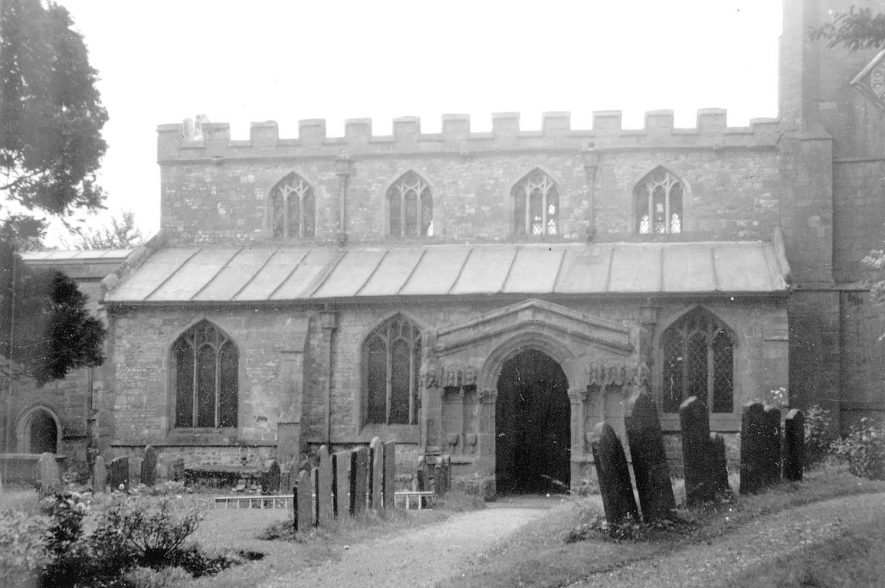 St Botolph's Church, showing porch, part of south side & part of graveyard, Newbold on Avon.  1950s |  IMAGE LOCATION: (Warwickshire County Record Office)