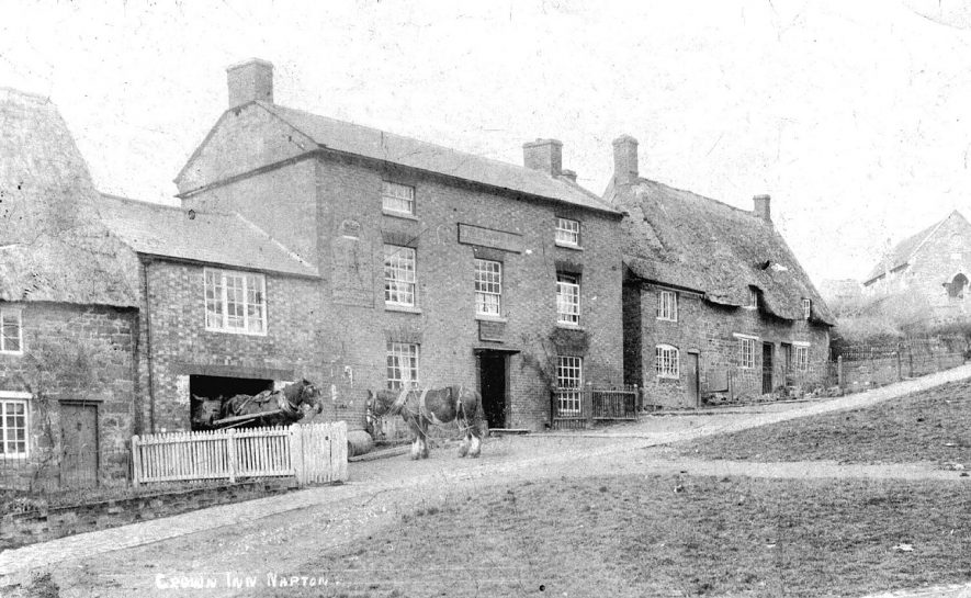 The Crown Inn, Napton on the Hill. Two cart horses are in front of the inn.  1900s |  IMAGE LOCATION: (Warwickshire County Record Office)