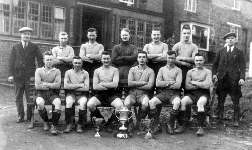 Napton on the Hill football team in front of The Crown Inn.  1920s |  IMAGE LOCATION: (Warwickshire County Record Office)