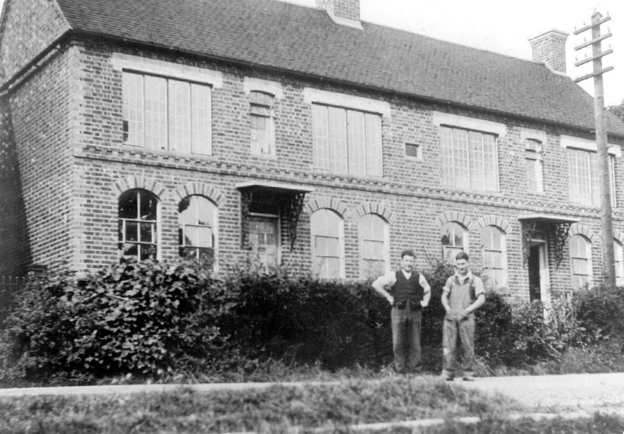Napton on the Hill police house, with two builders standing in front.  1920s |  IMAGE LOCATION: (Warwickshire County Record Office)