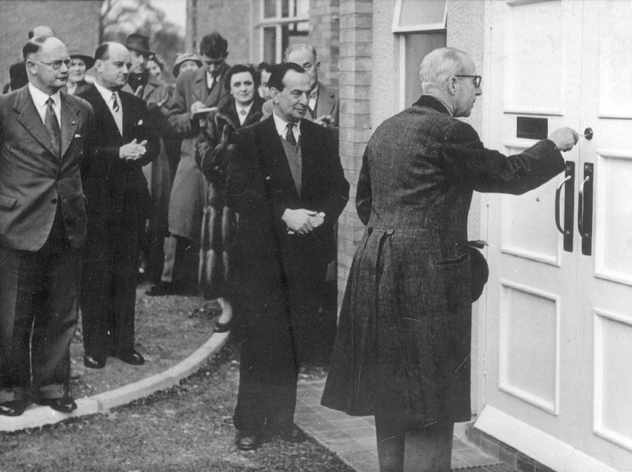Official opening  of the Victory Club, Napton on the Hill. The ceremony was performed by Lord Willoughby de Broke and also in the picture are from left to right - Mr. Chas Watson, who compiled the original plan, Mr. Cyril Watson, who built the club , Mrs C Watson and Sir Charles Shuckburgh, club president.  1956 |  IMAGE LOCATION: (Warwickshire County Record Office) PEOPLE IN PHOTO: Willoughby, Lord de Broke, Willoughby, de Broke as a surname, Watson, Mrs C, Watson, Cyril, Watson, Chas, Shuckburgh, Sir Charles, Shuckburgh as a surname