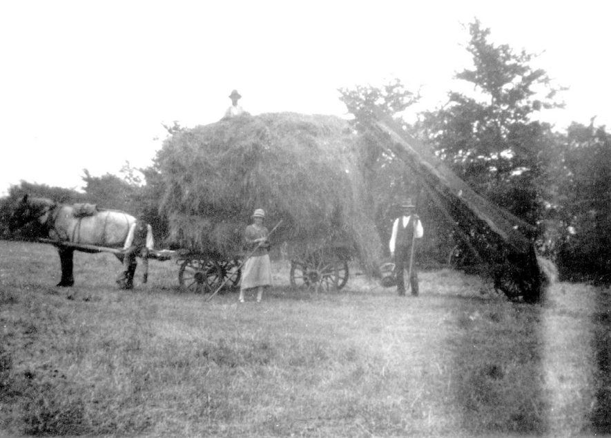 Loaded haywain, horse, two men and a woman at Napton on the Hill.  1928 |  IMAGE LOCATION: (Warwickshire County Record Office)