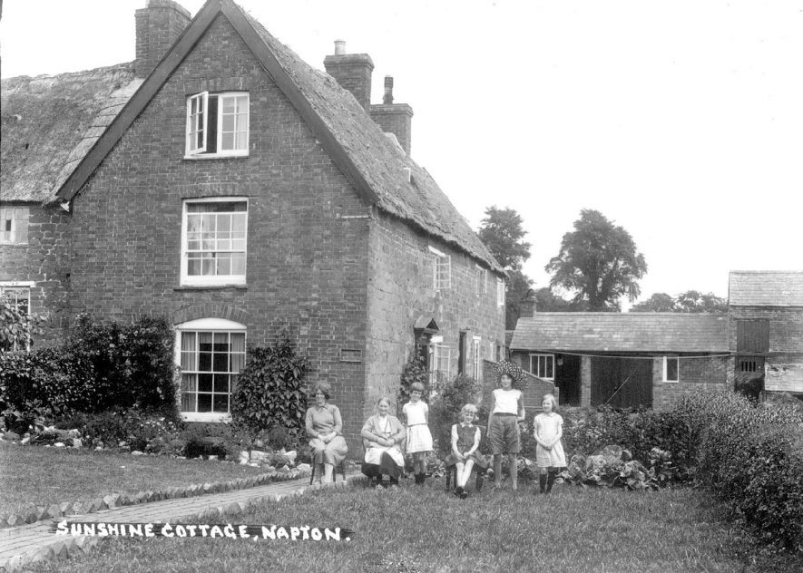 Sunshine Cottage, with women and children at front of house, Napton on the Hill.  1920s |  IMAGE LOCATION: (Warwickshire County Record Office)