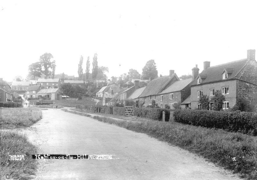 Street and cottages, Napton on the Hill.  1920s [View looking up the High St.. The large red bricked house on the right is The Rosary where Mr A Payne, the village school master lived.] |  IMAGE LOCATION: (Warwickshire County Record Office)