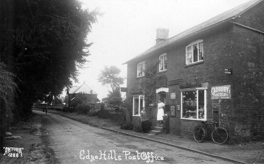 Edgehill Post Office. Two women in doorway. Brick house in distance.  1920s. |  IMAGE LOCATION: (Warwickshire County Record Office)
