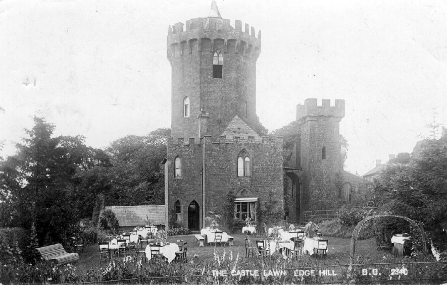 The Castle, Edgehill showing tables set out on lawn.  1910s |  IMAGE LOCATION: (Warwickshire County Record Office)