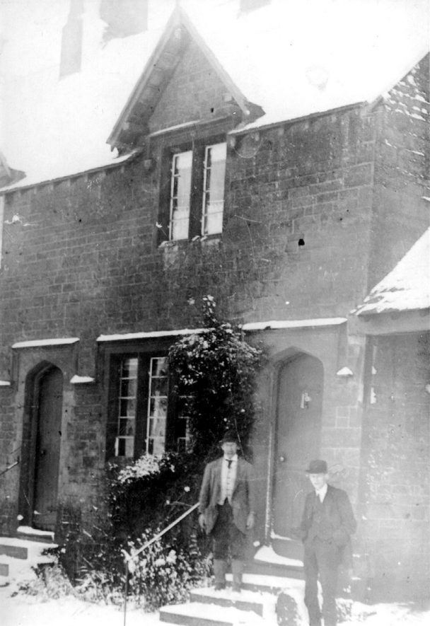 Two men standing outside Woodbine Cottage in Ratley.  1900s |  IMAGE LOCATION: (Warwickshire County Record Office)