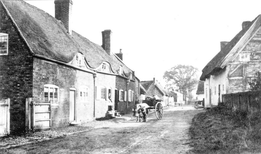Cottages in Coventry Road, Pailton. A horse and cart are standing in the road.  Circa 1890 |  IMAGE LOCATION: (Warwickshire County Record Office)