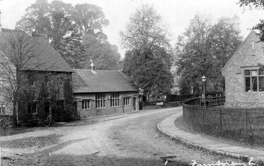Part of village street showing cottage and two single storey stone buildings, which may be a school and village hall, Farnborough. 1900s[The single storey building was the old school, the house next to the school was the old schoolmasters house and the building opposite was the Reading Room both of which are now private residences] |  IMAGE LOCATION: (Warwickshire County Record Office)