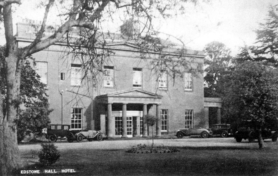 Edstone Hall Hotel. Front elevation with portico. Four motor cars.  1920s |  IMAGE LOCATION: (Warwickshire County Record Office)