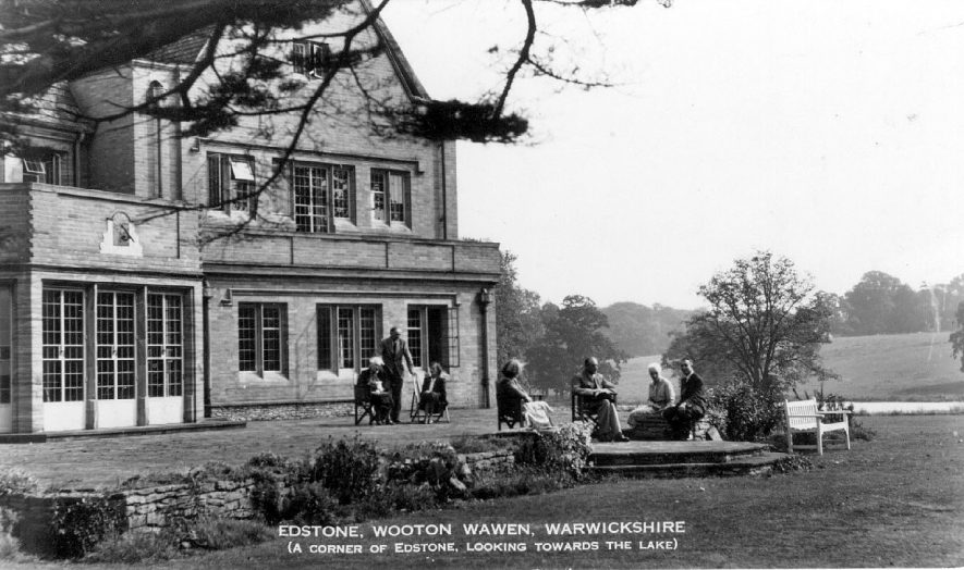 Edstone Hall Hotel. Part of rear elevation with terrace and lake.  1930s |  IMAGE LOCATION: (Warwickshire County Record Office)