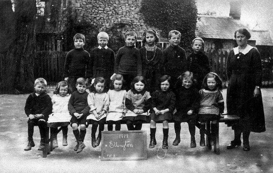 Group picture of the pupils of the village school and their teacher, Ettington.  1919 |  IMAGE LOCATION: (Warwickshire County Record Office)
