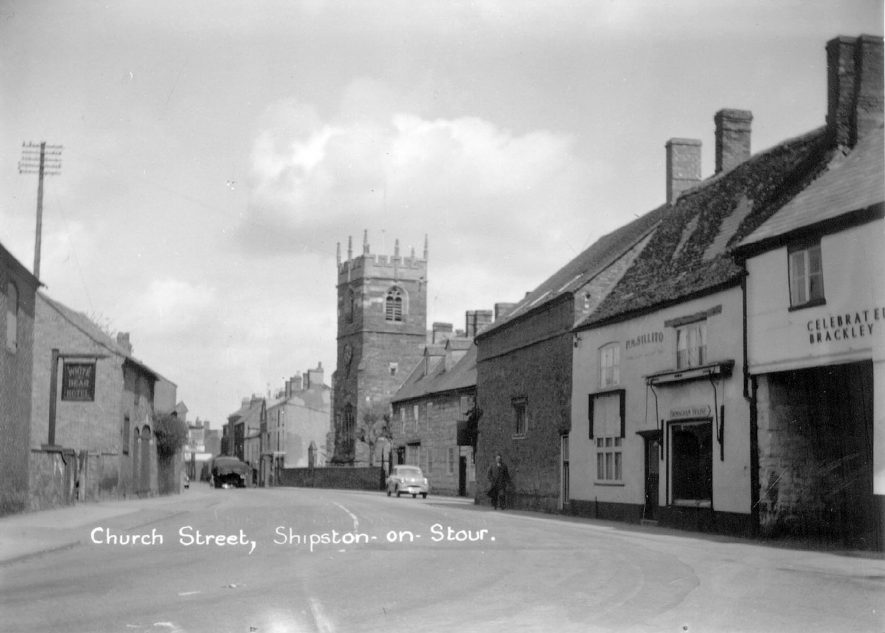 Looking along Church Street, with St Edmund's church in the background. Shipston on Stour.  1950s    IMAGE LOCATION: (Warwickshire County Record Office)