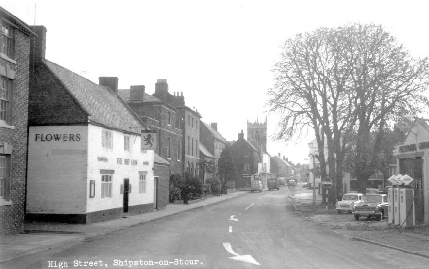 Looking along Church Street (not High Street as shown on the photograph), with St Edmund's church in the background and The Red Lion on the left. Shipston on Stour.  1960s |  IMAGE LOCATION: (Warwickshire County Record Office)