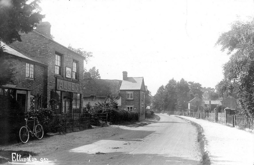 The main street showing a parked bicycle near to Mr Allen's shop, Ettington.  1900s |  IMAGE LOCATION: (Warwickshire County Record Office)