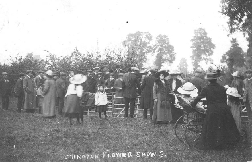 Flower show and group of onlookers, Ettington.  1900s |  IMAGE LOCATION: (Warwickshire County Record Office)
