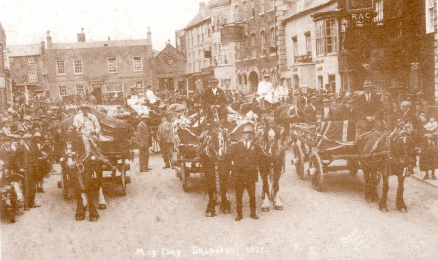 Parade of horses and decorated carts celebrating May Day. High Street, Shipston on Stour.  1927 |  IMAGE LOCATION: (Warwickshire County Record Office)