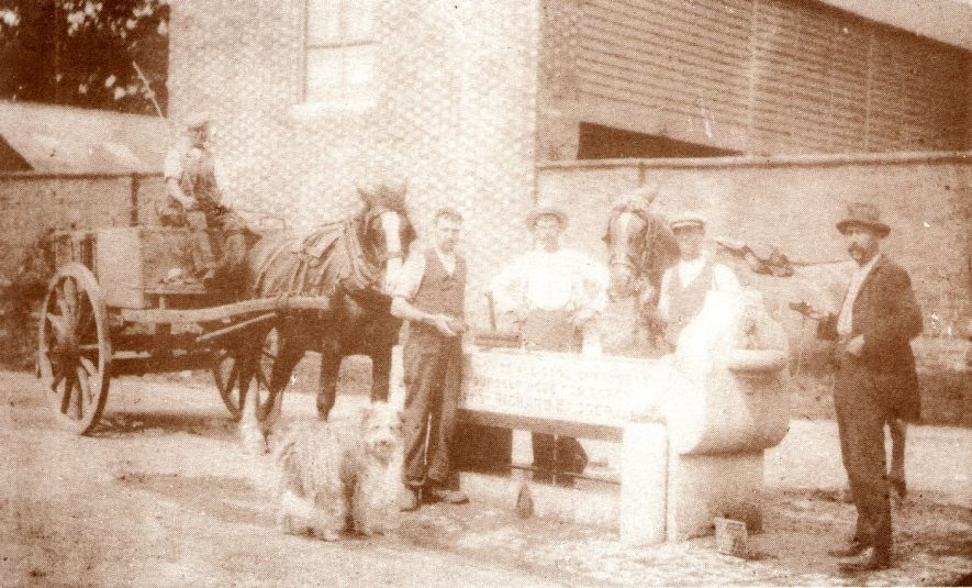 Group of men with horse and cart at the Horsefair horse trough, Shipston on Stour.  Circa 1910 |  IMAGE LOCATION: (Warwickshire County Record Office)