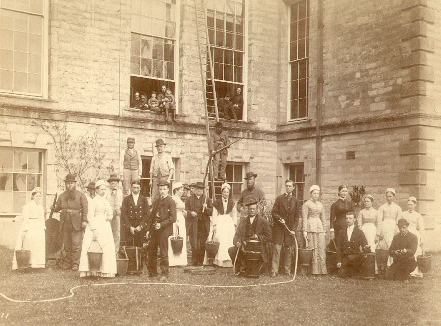 Ragley Hall servants fire brigade assembled outside Ragley Hall.  1880s |  IMAGE LOCATION: (Warwickshire County Record Office)