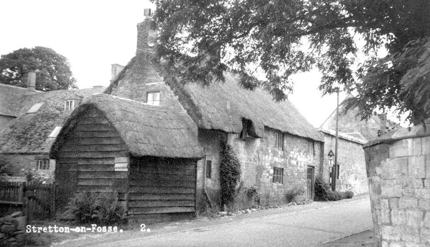 Thatched cottages and other buildings in Stretton on Fosse.  1960s |  IMAGE LOCATION: (Warwickshire County Record Office)