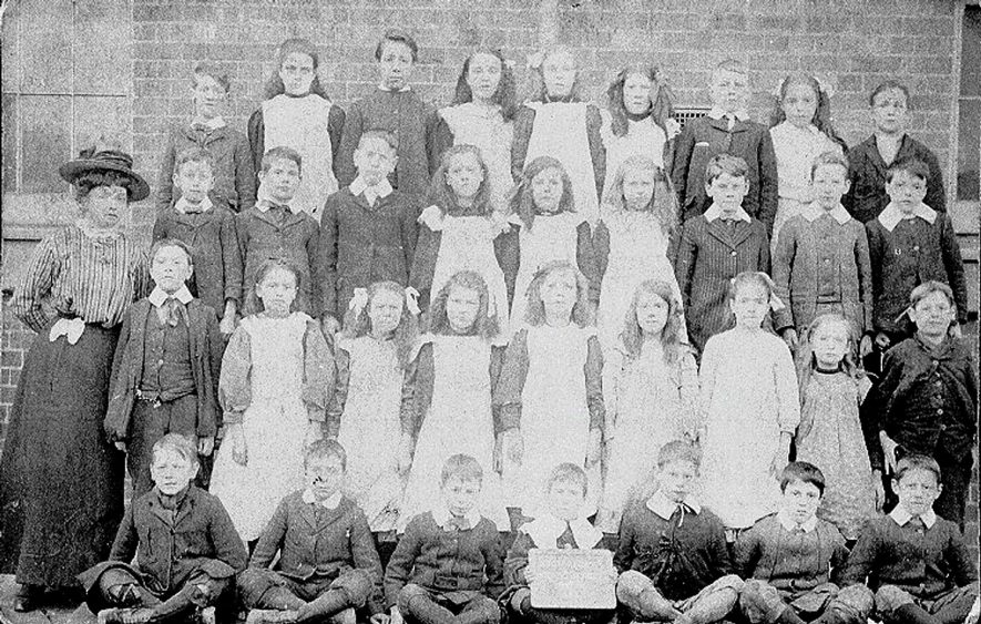 Stockingford council school photograph of the boys and girls in group 8 with their teacher.  1900s |  IMAGE LOCATION: (Warwickshire County Record Office)