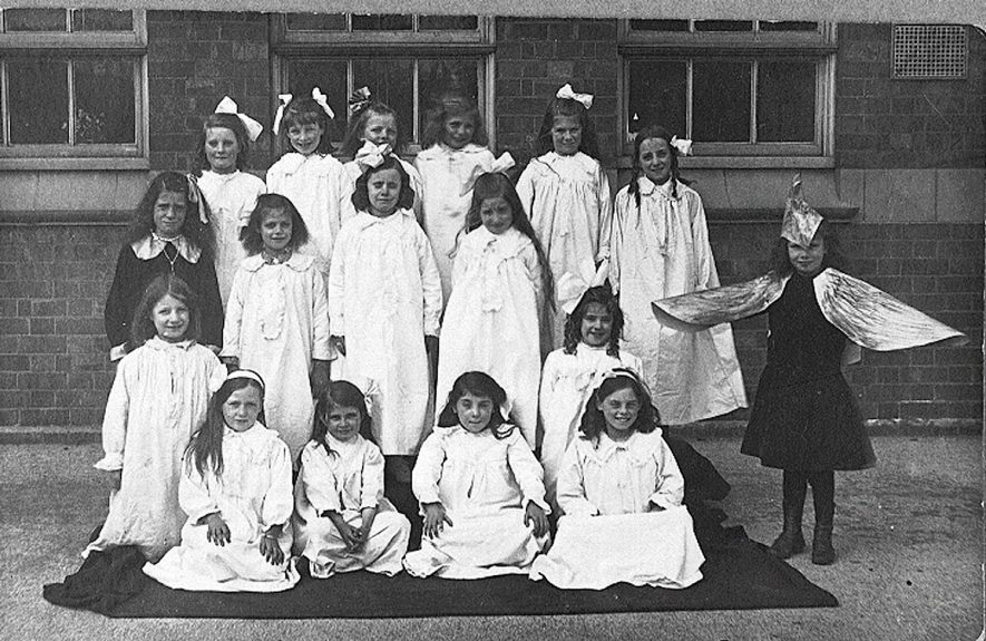 Stockingford council school photograph of a group of girls in fancy dress.  1920s |  IMAGE LOCATION: (Warwickshire County Record Office)