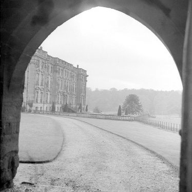 Stoneleigh.  Abbey viewed through an archway