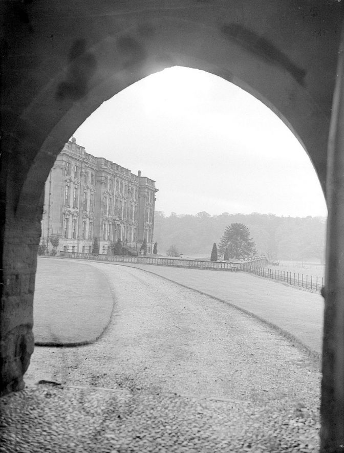 Stoneleigh Abbey as seen through an archway.  November 11th 1938 |  IMAGE LOCATION: (Warwickshire County Record Office)
