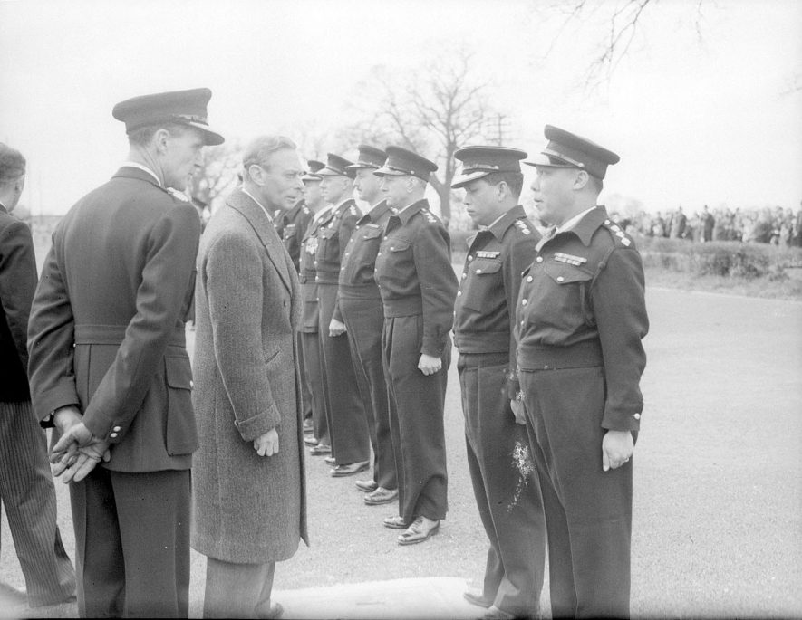 King George VI talking to colonial police officer cadets at the Ryton on Dunsmore police training college.  April 5th 1951 |  IMAGE LOCATION: (Warwickshire County Record Office) PEOPLE IN PHOTO: George VI